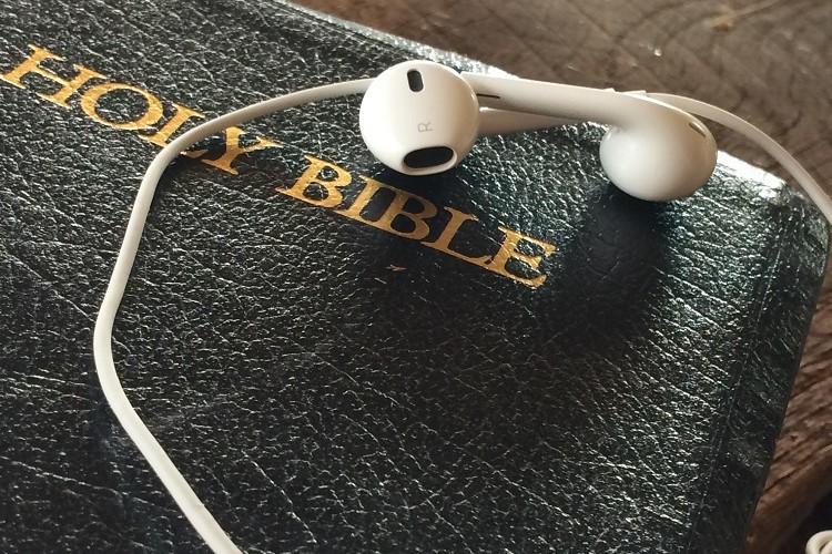 Bible with earbuds